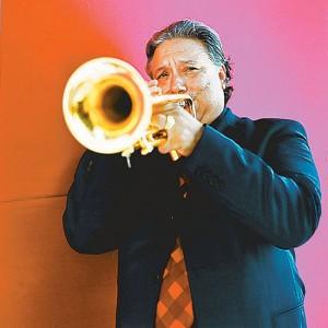 Arturo Sandoval holding a trumpet.